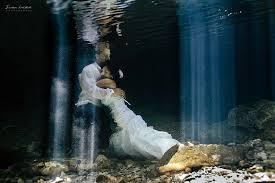 trash the dress dear to do something different underwater wedding trash the dress