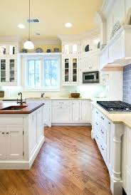 white kitchen cabinets with oak flooring kitchen white kitchen wood floor white kitchen with wood