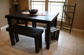 old and vintage pub style dining sets with black painted wood dining table with bench seat for small dining room spaces and white ceramic floor tiles ideas