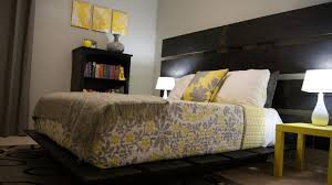 gray and yellow bedroom walls oak end bed stool dark covered bed
