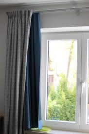 curtain rail drapes decorate the house with beautiful curtains