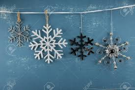 hanging picture height snowflake ornaments in descending height hanging from white ribbon