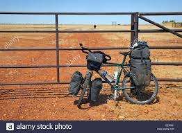 touring bicycle equipped with panniers and handlebar bag in the