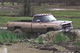 jeep stuck in mud video 1st gen cummins goes one mud hole too far
