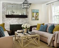 whitewash fireplace with accent wall living room beach style and