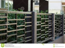 black steel fence of residential house modern stock photo image
