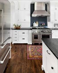 kitchen with black island and white cabinets white cabinets with black countertops 12 inspiring designs