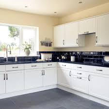 white kitchen cabinets black tile floor when looking at kitchen designs and ideas there are a