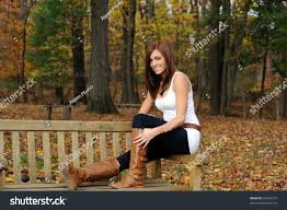bench young beautiful woman sitting on a bench in a city park