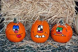 fun faces painted on pumpkins stock photo picture and royalty