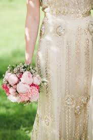 wedding flowers with champagne dress cream and white bridal