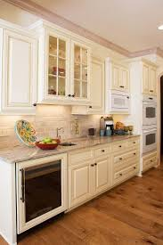 cream kitchen cabinets with glaze doors gray walls gloss wood trim