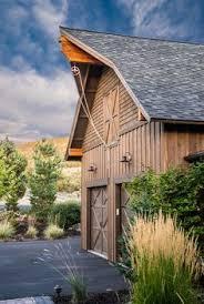 barn style garage with apartment plans gambrel barn board and batten cedar shakes on house gambrel