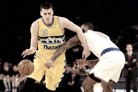 nikola jokic spearhead denver nuggets to victory over new york