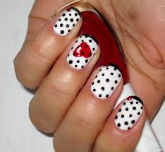 yellow nails with red hearts nail art