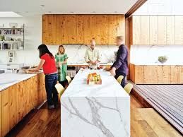 photo 4 of 11 in 10 modern examples that show how to use marble in the kitchen is beautifully textured and veined thanks to white carrara marble countertops installed by new