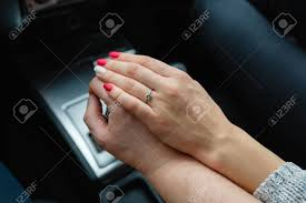 car girl rings images A young couple in love holding hands holding on the shift lever jpg