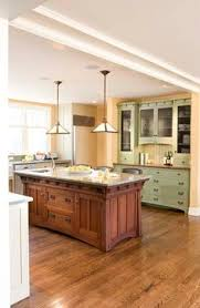elegantly simple modern craftsman style kitchen cabinets shown