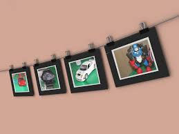 hang a string of pictures on a wall empty wall hanging photos