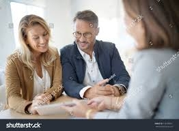 mature couple meeting realestate agent office stock photo