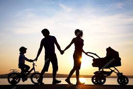 happy family walking on sunset stock photo yanlev 25009365
