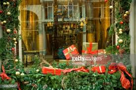 closeup of christmas decorations and gifts in a window display at