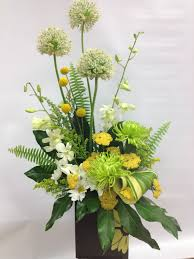 Arranging Flowers by A Beautiful Asymmetrical Arrangement In Green White And Yellow