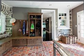mudroom tile floor built in white oak cabinets