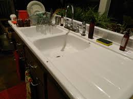 kitchen sink with backsplash unique farmhouse kitchen sink with drainboard ideas the clayton
