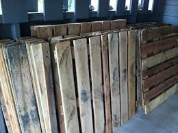 a family took wooden pallets and made them into hardwood floors