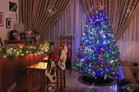 festive christmas tree decorated with blue lights and baubles