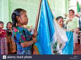 Flag Of Antigua Teacher Leading Kindergartner Class Of Mayan Children In Pledge Of