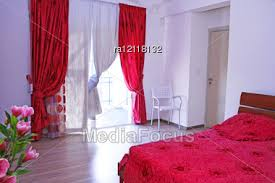 red bedroom curtains bedroom with pink curtains bedspread and flowers stock photo