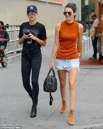 kendall jenner stands out in bright tank top and miniskirt with