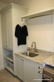 Laundry Room Cabinets With Sinks Hanging Rod And Shelf Ideas Laundry Room Traditional With Storage