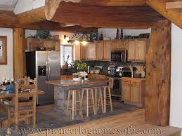 Small Post And Beam Homes Small L Shaped Kitchen With Stone Tile Wood Floors Round Log
