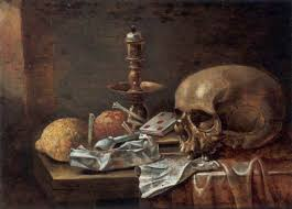 a vanitas still with a skull cards a candlestick a