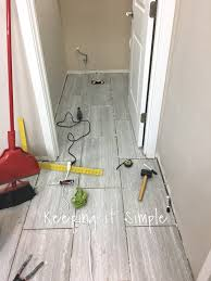 Silver Laminate Flooring Tips On How To Install Tile Flooring In A Bathroom With Ridgemont