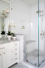 nice for downstairs bath reno home redo pinterest shower glass enclosed shower fitted with bench this traditional master bathroom space