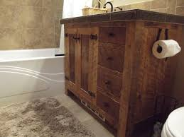 bathroom barn wood bathroom vanitywith shalef and door also