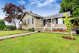 Curb Appeal Real Estate - american house exterior with curb appeal walkout deck with white