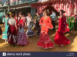 april fair young women dancing with the traditional flamenco