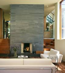 gray brick fireplace living room contemporary minimal side tables