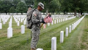Soldier With Flag Soldiers Honor Heroes With Flags At Arlington Cemetery Scripps