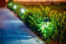 solar garden light lanterns in flower bed garden design clean