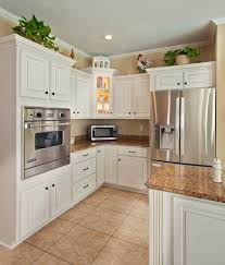 white kitchen cabinets with antique brown granite our top 5 antique white cabinet countertop pairings