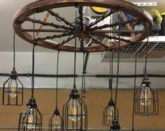 Mason Jar Wagon Wheel Chandelier Wagon Wheel Chandelier With Vintage Bulbs By Southerncharmbykaren