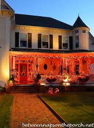 decorating for halloween with exterior lighting garland and lit orbs