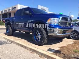 fuel wheels ram 1500 sitting on custom painted blue fuel maverick wheels fuel