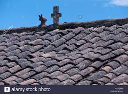 Ceramic Tile Roof An Old And Weathered Red Ceramic Tile Roof Detail Of The Catholic